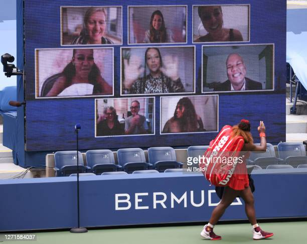 Serena Williams of the United States waves to the Jumbotron as she walks off courter after winning her Women's Singles quarterfinal match against...