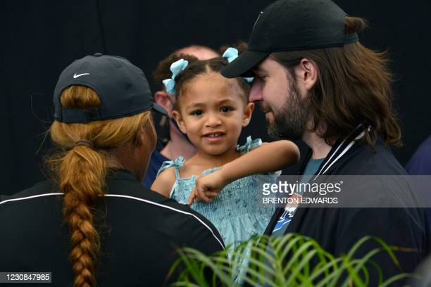 Serena Williams of the US and her husband Alexis Ohanian talk to their daughter Alexis Olympia Ohanian Jr during the 'A Day at the Drive' exhibition...