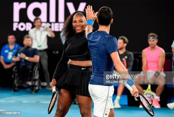 Serena Williams of the US and Novak Djokovic of Serbia share a lighter moment as they and other top players play in the Rally for Relief charity...