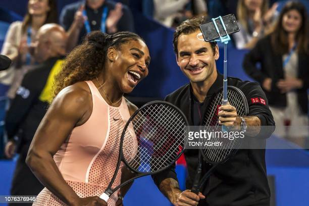 Serena Williams of the US and Roger Federer of Switzerland take a selfie following their mixed doubles match on day four of the Hopman Cup tennis...