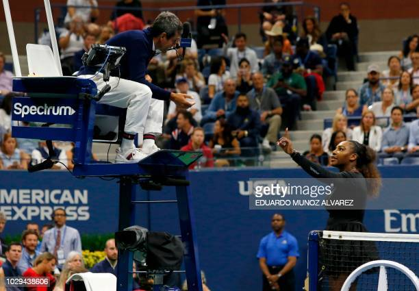 TOPSHOT Serena Williams of the US argues with chair umpire Carlos Ramos while playing Naomi Osaka of Japan during their 2018 US Open women's singles...