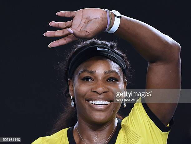 Serena Williams of the US celebrates after victory in her women's singles semifinal match against Poland's Agnieszka Radwanska on day eleven of the...