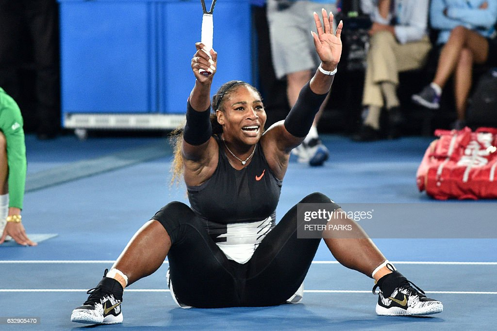 Serena Williams of the US celebrates her victory against Venus Williams of the US during the women's singles final on day 13 of the Australian Open tennis tournament in Melbourne on January 28, 2017. / AFP / PETER