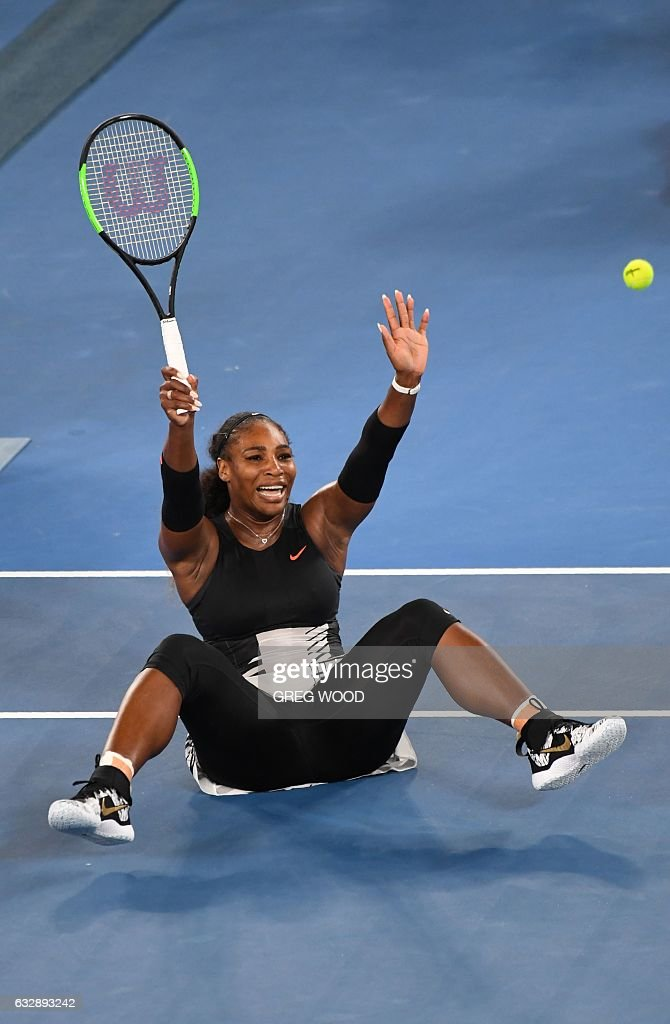 Serena Williams of the US celebrates her victory over Venus Williams of the US in the women's singles final on day 13 of the Australian Open tennis tournament in Melbourne on January 28, 2017. / AFP / Greg Wood / IMAGE
