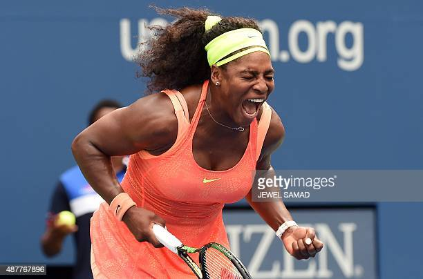 Serena Williams of the US celebrates winning a point against Roberta Vinci of Italy during their 2015 US Open Women's singles semifinals match at the...