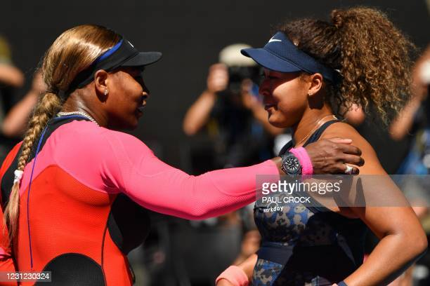 Serena Williams of the US congratulates Japan's Naomi Osaka on her win in their women's singles semi-final match on day eleven of the Australian Open...