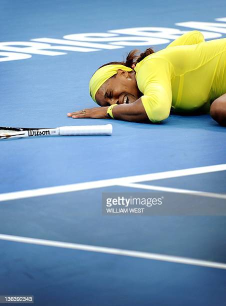 Serena Williams of the US cries out after injuring her ankle during her second round women's singles match against Bojana Jovanovski of Serbia at the...