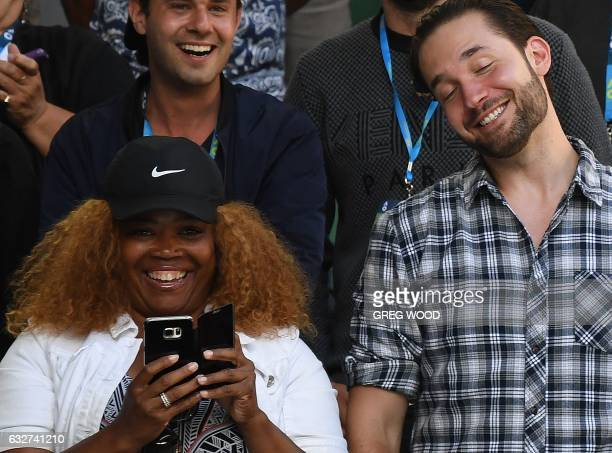 Serena Williams of the US' fiance Reddit cofounder Alexis Ohanian and her mother Oracene Price smile following her win against Croatia's Mirjana...