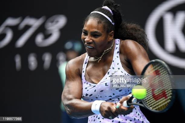 Serena Williams of the US hits a return against China's Wang Qiang during their women's singles match on day five of the Australian Open tennis...