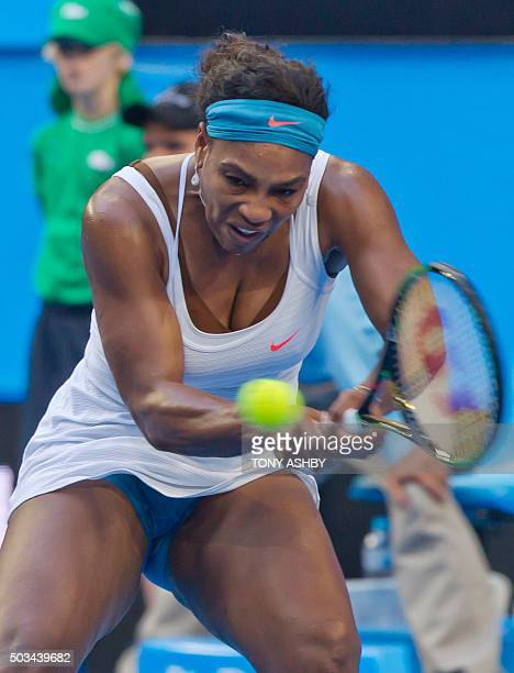 Serena Williams of the US hits a return against Jamila Wolfe of the Australia Gold team during their women's singles match on day three of the Hopman...