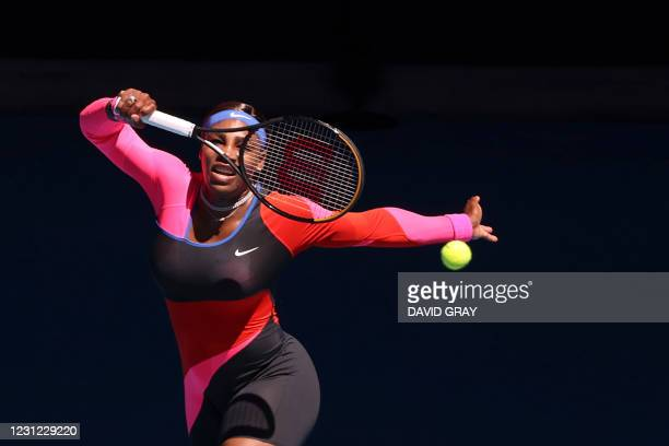 Serena Williams of the US hits a return against Japan's Naomi Osaka during their women's singles semi-final match on day eleven of the Australian...