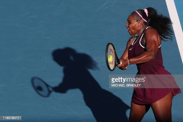 Serena Williams of the US hits a return against Jessica Pegula of the US during their women's singles final match during the Auckland Classic tennis...