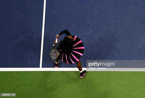TOPSHOT Serena Williams of the US hits a return against Vania King of the US during their 2016 US Open Womens Singles match at the USTA Billie Jean...