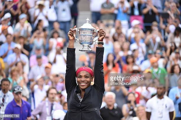 Serena Williams of the US holds the US Open trophy after defeating Caroline Wozniacki of Denmark during their US Open 2014 women's singles finals...