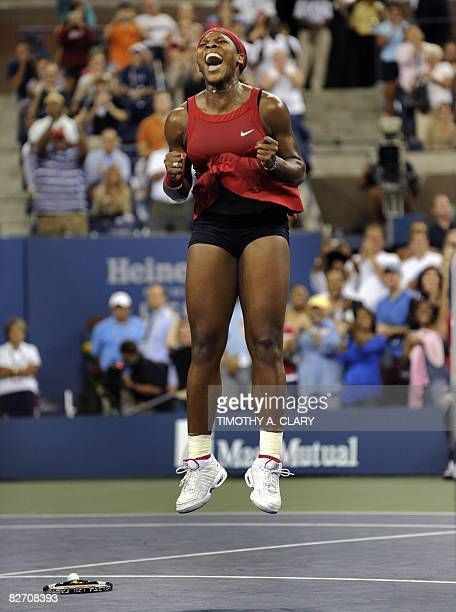 Serena Williams of the US jumps in the air after winning her finals match to Jelena Jankovic of Serbia at the US Open tennis tournament on...