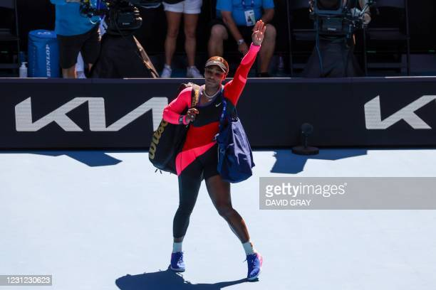 Serena Williams of the US leaves the court after being defeated by Japan's Naomi Osaka at the end of their women's singles semi-final match on day...