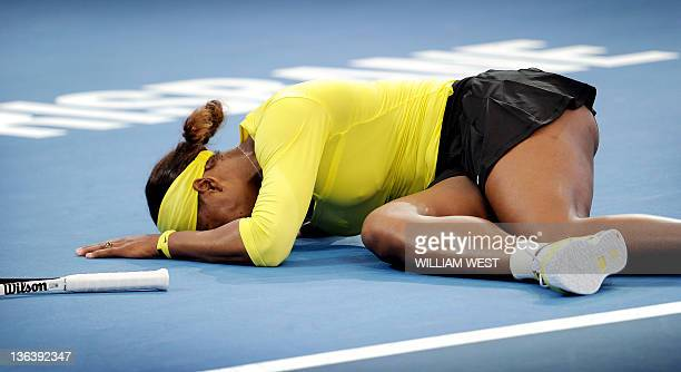 Serena Williams of the US lies on the court after injuring her ankle during her second round match against Bojana Jovanovski of Serbia at the...