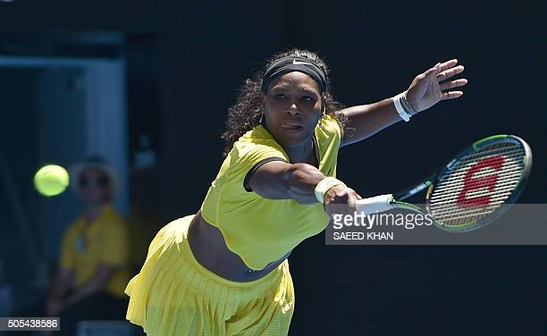 TOPSHOT Serena Williams of the US plays a backhand return during her women's singles match against Italy's Camila Giorgi on day one of the 2016...