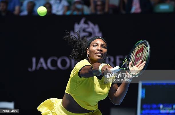 Serena Williams of the US plays a backhand return during her women's singles match against Russia's Margarita Gasparyan on day seven of the 2016...