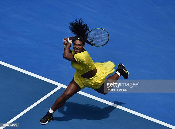 TOPSHOT Serena Williams of the US plays a backhand return during her women's singles match against Russia's Maria Sharapova on day nine of the 2016...