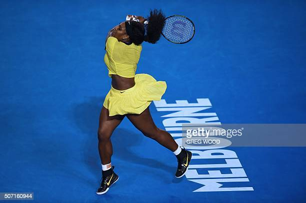 TOPSHOT Serena Williams of the US plays a backhand return during her women's singles semifinal match against Poland's Agnieszka Radwanska on day...