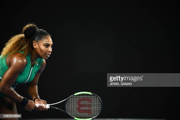 Serena Williams of the US prepares to return serve against Canada's Eugenie Bouchard during their women's singles match on day four of the Australian...