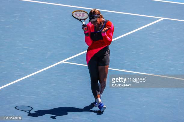Serena Williams of the US reacts after a point against Japan's Naomi Osaka during their women's singles semi-final match on day eleven of the...