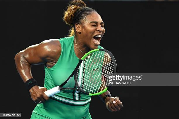 TOPSHOT Serena Williams of the US reacts after a point against Romania's Simona Halep during their women's singles match on day eight of the...