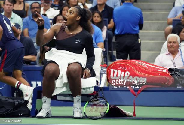TOPSHOT Serena Williams of the US reacts against Naomi Osaka of Japan during their Women's Singles Finals match at the 2018 US Open at the USTA...