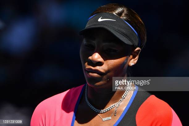 Serena Williams of the US reacts as she plays against Japan's Naomi Osaka during their women's singles semi-final match on day eleven of the...