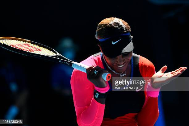 Serena Williams of the US reacts on a point against Japan's Naomi Osaka during their women's singles semi-final match on day eleven of the Australian...