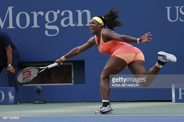 Serena Williams of the US returns a shot to compatriot Madison Keys during their 2015 US Open Women's singles round 4 match at the USTA Billie Jean...