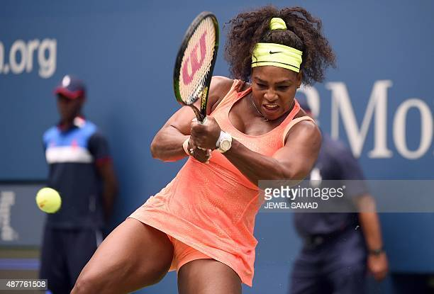 Serena Williams of the US returns the ball to Roberta Vinci of Italy during their 2015 US Open Women's singles semifinals match at the USTA Billie...