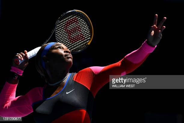 Serena Williams of the US serves against Japan's Naomi Osaka during their women's singles semi-final match on day eleven of the Australian Open...