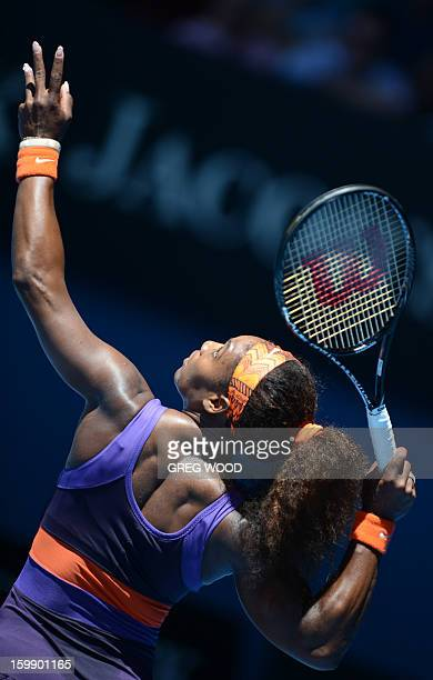 Serena Williams of the US serves during her women's singles match against compatriot Sloane Stephens on the tenth day of the Australian Open tennis...