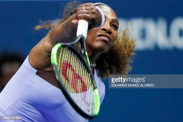 Serena Williams of the US serves to Carina Witthoeft of Germany during Day 3 of the 2018 US Open Women's Singles match at the USTA Billie Jean King...