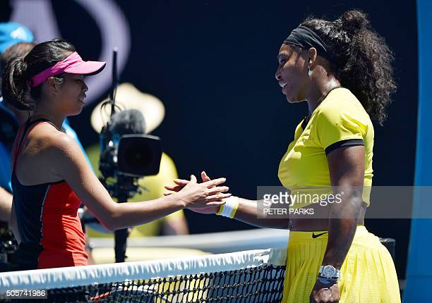Serena Williams of the US shakes hands after victory in her women's singles match against Taiwan's Hsieh SuWei on day three of the 2016 Australian...