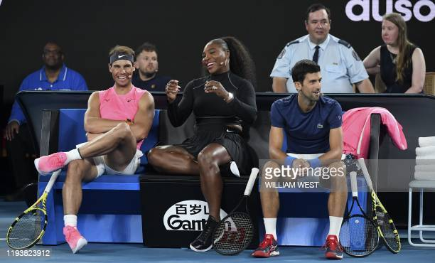 TOPSHOT Serena Williams of the US shares a lighter moment with Rafael Nadal of Spain and Novak Djokovic of Serbia as they and other top players play...