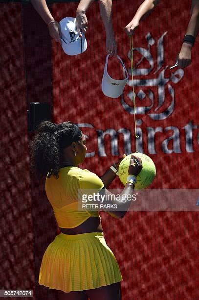 Serena Williams of the US signs autographs after victory in her women's singles match against Taiwan's Hsieh SuWei on day three of the 2016...
