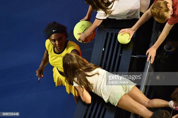 Serena Williams of the US signs autographs after winning her women's singles match against Russia's Daria Kasatkina on day five of the 2016...