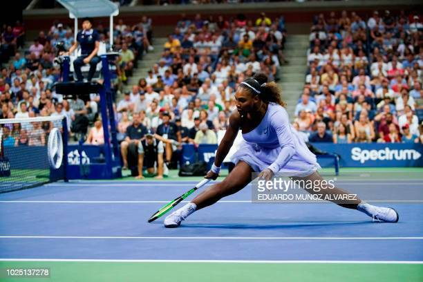 Serena Williams of the US slides after hitting a return to Carina Witthoeft of Germany during Day 3 of the 2018 US Open Women's Singles match at the...