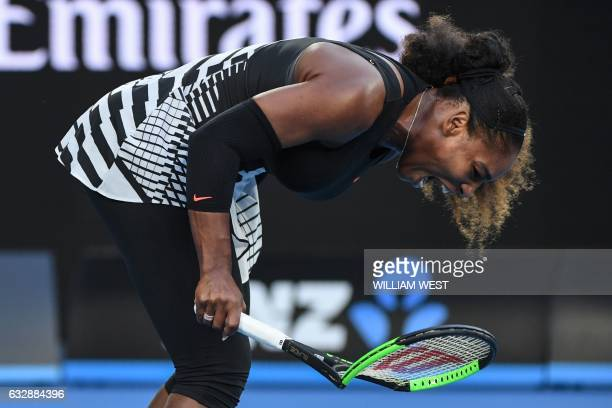 TOPSHOT Serena Williams of the US smashes her racquet after a point against Venus Williams of the US during the women's singles final on day 13 of...