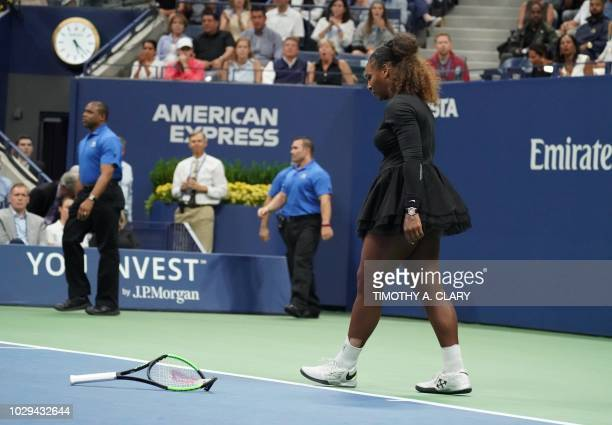 Serena Williams of the US smashes her racquet while playing against Naomi Osaka of Japan during their Women's Singles Finals match at the 2018 US...