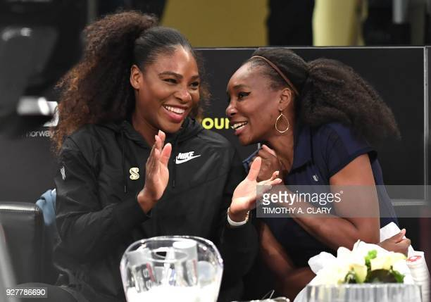 Serena Williams of the US speaks with her sister Venus WIlliams before their matches in the Tie Break Tens New York tournament at Madison Square...