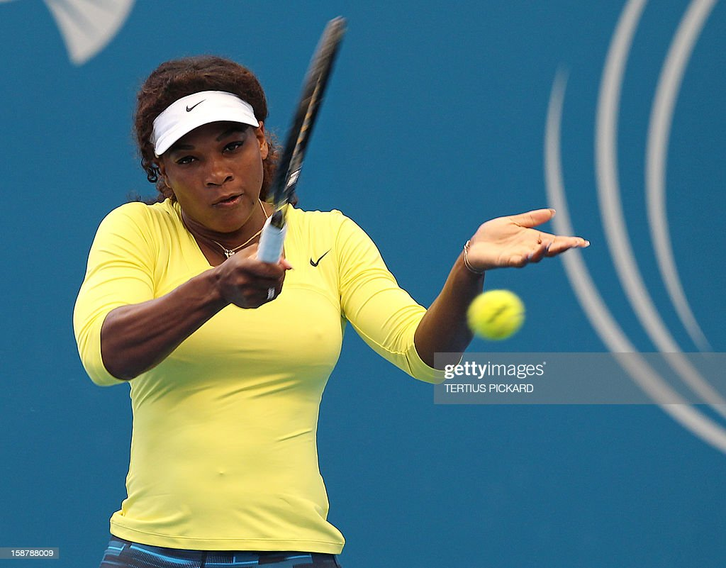 Serena Williams of the US takes part in a training session in Brisbane on December 29, 2012, before the upcoming Brisbane International tennis tournament. Top international men's and women's players are using the Brisbane International as a build-up to the Australian Open, which runs from January 14 to 27. AFP PHOTO/Tertius PICKARD USE