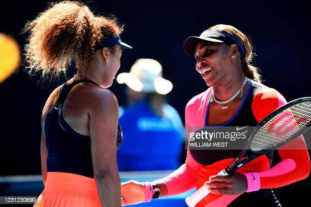 Serena Williams of the US talks to Japan's Naomi Osaka after their women's singles semi-final match on day eleven of the Australian Open tennis...