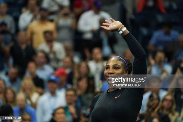 Serena Williams of the US waves to the crowd after defeating Qiang Wang of China in their Women's Singles Quarterfinals tennis match during the 2019...
