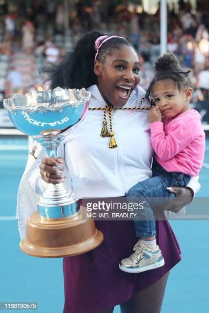 Serena Williams of the US with her daughter Alexis Olympia after her win against Jessica Pegula of the US during their women's singles final match...