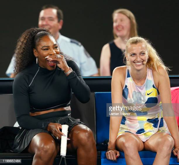Serena Williams of the USA and Petra Kvitova of the Czech Republic laugh during the Rally for Relief Bushfire Appeal event at Rod Laver Arena on...