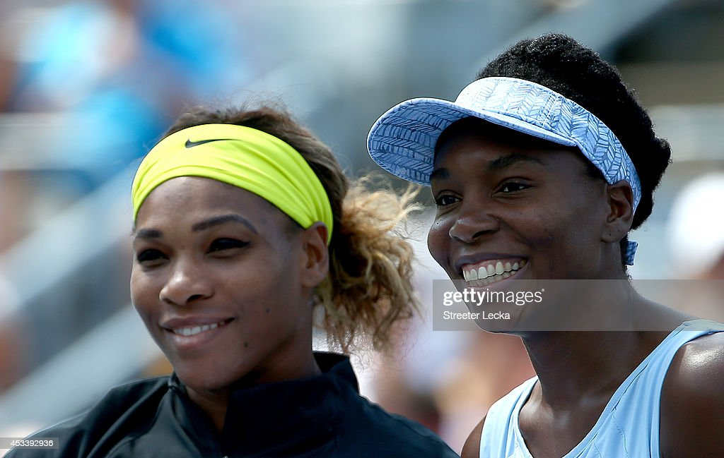 Serena Williams of the USA and Venus Williams of the USA pose before their women's semifinals match in the Rogers Cup at Uniprix Stadium on August 9, 2014 in Montreal, Canada.